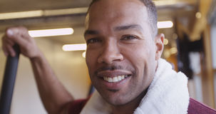 Close up portrait of happy smiling fit black man in gym after working out Royalty Free Stock Images