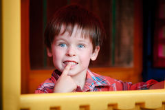 Close up portrait of happy smiling little boy. With finger on lips Stock Image