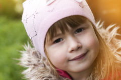 Close-up portrait of happy smiling pretty little girl. Soft ligh Stock Photos