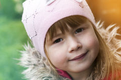 Close-up portrait of happy smiling pretty little girl. Soft ligh Royalty Free Stock Photos