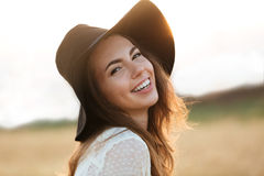 Close up portrait of a happy smiling woman with long hair Stock Photos