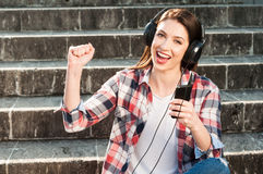 Close-up portrait of happy  woman listening to music on headphon Stock Images