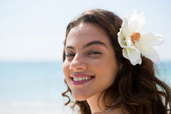 Close up portrait of happy woman wearing flower Stock Image