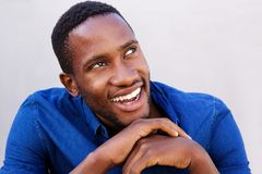 Happy young african man looking away and smiling Stock Photos