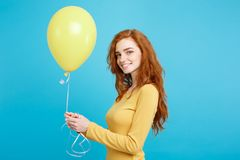 Celebrating Concept - Close up Portrait happy young beautiful attractive redhair girl smiling with colorful party stock photography