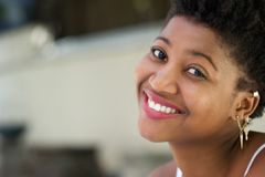 Close up portrait of a happy young black woman royalty free stock photos