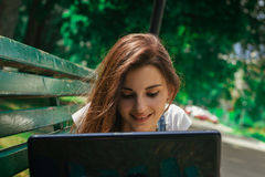 Close-up portrait of a happy young Brunettes with a laptop. On the street Stock Photo