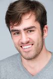 Close up portrait of a happy young man. On gray background Royalty Free Stock Images