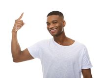 Close up portrait of a happy young man pointing finger Royalty Free Stock Photo