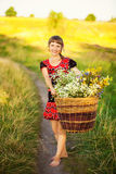 Close up Portrait of Happy Young Woman with with Basket full of Royalty Free Stock Photography