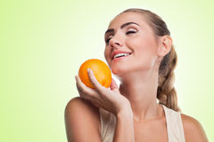 Close-up portrait of happy young woman with juice Royalty Free Stock Images