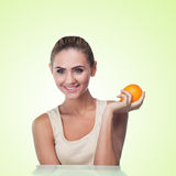 Close-up portrait of happy young woman with juice Stock Image