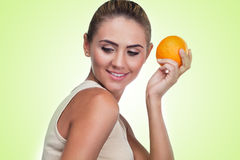 Close-up portrait of happy young woman with juice Stock Photography
