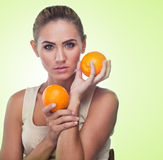 Close-up portrait of happy young woman with juice Stock Photos