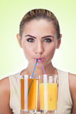Close-up portrait of happy young woman with juice on white backg Stock Photography