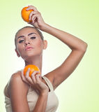 Close-up portrait of happy young woman with juice on white backg Royalty Free Stock Photo