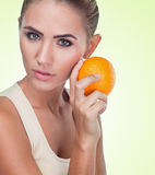 Close-up portrait of happy young woman with juice on white backg Royalty Free Stock Image