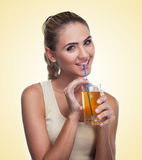 Close-up portrait of happy young woman with juice on white backg Royalty Free Stock Photos