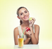 Close-up portrait of happy young woman with juice on white backg Stock Image