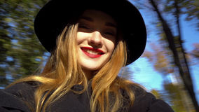 Close up portrait of happy young woman. With red lips smiling in hat with wide brim outdoors Stock Photos