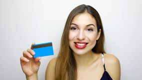 Close up portrait of happy young woman with showing credit card isolated over white background stock photos