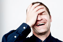 Close up portrait of hard laughing man Stock Photo