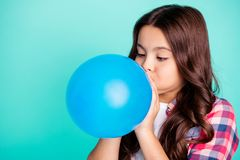 Close-up portrait of her she nice attractive cute charming wavy-haired girl in checked shirt blowing festive baloon fest. Isolated on bright vivid shine green royalty free stock photos