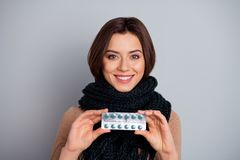 Close-up portrait of her she nice attractive lovely charming cute cheerful cheery girl holding in hands showing meds. Close-up portrait of her she nice royalty free stock images
