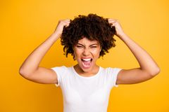 Close-up portrait of her she nice attractive miserable aggressive desperate nervous frustrated wavy-haired lady. Screaming loudly tearing hair on head isolated royalty free stock photos