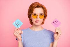 Close-up portrait of her she nice cute charming attractive confused girl wearing casual blue t-shirt yellow glasses stock photography