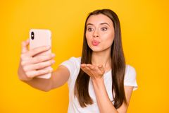 Close-up portrait of her she nice cute charming lovely sweet winsome attractive coquettish straight-haired girl taking. Making selfie sending kiss isolated over royalty free stock photo