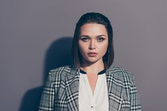 Close-up portrait of her she nice lovely beautiful attractive chic classy candid lady wearing checked blazer economist. Lawyer attorney isolated over gray stock image