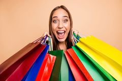 Close-up portrait of her she nice tanned fascinating attractive lovely cheerful cheery crazy glad straight-haired lady. Holding in hands bags with new clothes royalty free stock photos