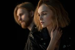 Close up portrait of hipster couple in black leather jackets stock photos