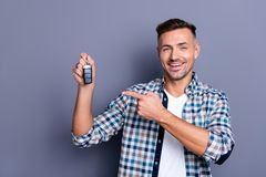 Close-up portrait of his he nice attractive confident content cheerful bearded guy holding in hand remote lock alarm. Close-up portrait of his he nice attractive royalty free stock photos