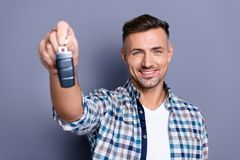Close-up portrait of his he nice attractive content cheerful cheery glad bearded guy holding in hand giving remote lock. Close-up portrait of his he nice stock photos
