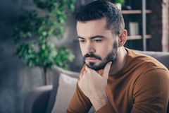 Close-up portrait of his he nice-looking attractive bearded sad minded moody guy spending spare time thinking at. Close-up portrait of his he nice-looking royalty free stock images