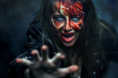 Close-up portrait of horrible zombie woman. Horror. Halloween Stock Image