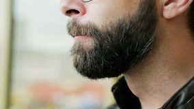 Close-up portrait of hungry bearded man eating ice cream stock video footage