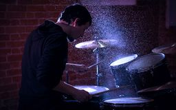 Close up Portrait of immersed and concentrated drummer rehearsin Royalty Free Stock Images