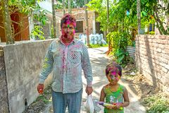 Close up portrait of Indian father and daughter celebrating Holi stock images