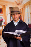 Close up portrait of indigenous latin young man holding file folder Royalty Free Stock Photography