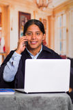 Close up portrait of indigenous young latin man using laptop Royalty Free Stock Images