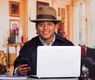 Close up portrait of indigenous young latin man using laptop Stock Photo