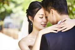 Loving asian newly-wed Royalty Free Stock Photo