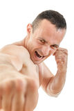 Close up portrait of kick boxer fighter punching with expression royalty free stock photography
