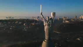 Close up portrait. Kiev Ukraine the most popular tourist places to visit The Motherland Monument. Aerial drone video. Footage of huge steel statue of woman with stock video footage