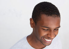 Close up portrait of a laughing black guy Royalty Free Stock Photos