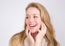 Close up portrait of a laughing young woman Stock Photos
