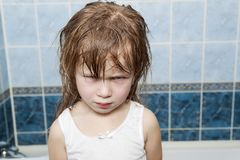 Close-up portrait of little aggressive angry child girl.  royalty free stock photo